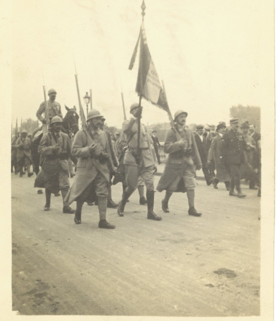 27. Color Bearers of a French regiment in the July 14th 1917 Parade passing the Bastille. Notice the steel trench helmets and cutaway coats of the 'Poilus'
